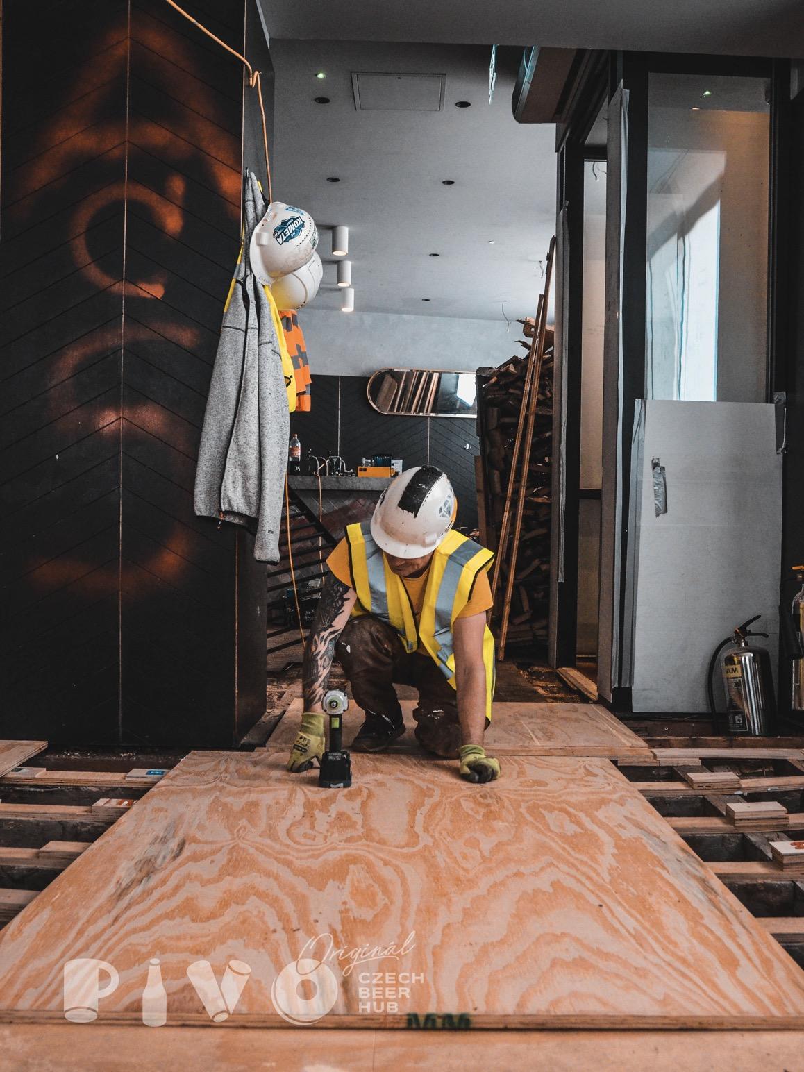 man working on czech beer pub reconstruction
